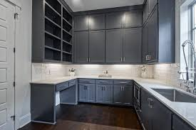dark gray blue stacked pantry cabinets with white quartz countertop