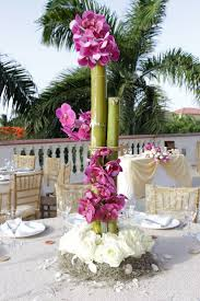 Bamboo and orchids make for such unique and tall centerpieces for your  destination wedding at Dreams Rivera Cancun Resort & Spa!