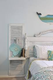 Awesome shutter nightstands built onto a headboard made from an old