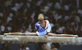 dominique dawes of the usa on the beam during the womens team gymnastics event at the