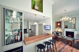 transitional u shaped medium tone wood floor seated home bar photo in london with wood