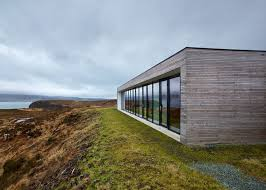 cliff house by dualchas architects offers panoramic views of a scottish loch