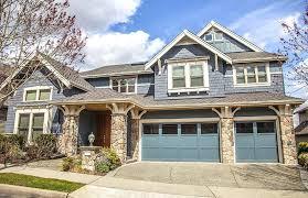 garage door paint ideas bright blue garage doors on darker blue house with white window trim