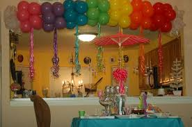 rainbow balloon arch to welcome guests to care a lot care bears