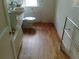 Bathroom Tile Floor Attractive 9 Bathroom With Hardwood Tile On Wood Flooring Gallery