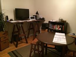 my new home office staring a homemade standing desk let me know what you think of the early progress and please offer suggestions on how i can make it