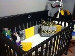 nursery design using batman room ideas plus black crib and grey wall