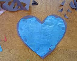 glue tissue paper to the back of the heart cut out faux stained glass hearts