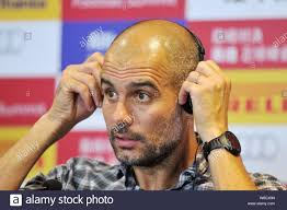 Head coach Pep Guardiola of Bayern Munich puts on a headphone at a press  conference after his team defeated Inter Milan during a friendly soccer  match Stock Photo - Alamy