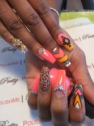 Tribal print nail art with Swarovski crystals coffin shape nails ...