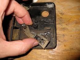 picture of disemble the dead bolt mechanism