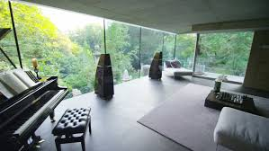 interior view of elegant living area in a stylish contemporary home with large glass panels natural views no people