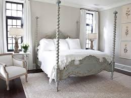 trendy french country bedrooms decoration ideas with vintage wooden canopy bed frame also white bedding sets plus cozy armchair and glass flower vase