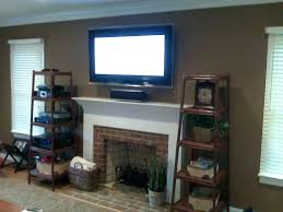 mount tv to brick fireplace mount over fireplace above fireplace where to put cable box and mount tv to brick fireplace