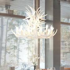 modern antler chandelier twig 9 light modern antler chandelier white painting candle regarding antler chandelier view