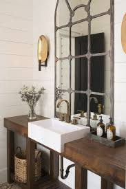 i like this bathroom sink look the best built into the wood also think the mirror is cool plus i like the color of the hardware love the use of the