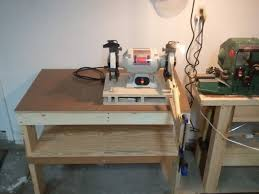 bench grinder table. the clamp on end is because i just glued this piece on, it was removed shortly after these pics. bench grinder table