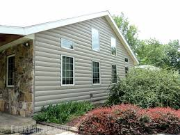 faux brick vinyl siding. vinyl log siding in smoke color installed on a ranch home\u0027s side exterior. faux brick e