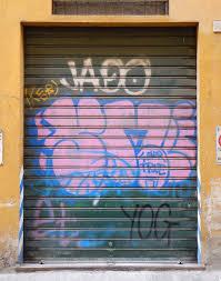 metal garage doorsTexture  metal garage door with murales spray paint  Metal doors