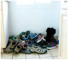 hall closet organization ideas and hall closet storage ideas pile of unorganized shoes before