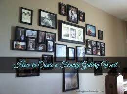 some great ideas and tips on creating a family wall of photos for your house