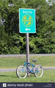 going to the s bicycle tied to a garden state parkway sign pointing south new jersey usa