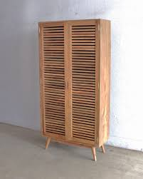 wooden shoe cabinet furniture. High Brown Wooden Shoe Storage Cabinet With Double Striped Doors And Four Legs On The Floor Furniture C