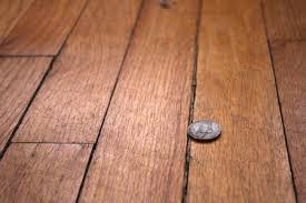 wood floor with gaps between floorboards