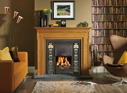 stovax art nouveau tiled convector fireplace in matt black with evening primrose 5 tile sets shown with carlton wooden mantel in light oak