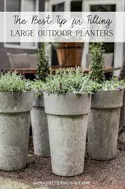 filling large outdoor planters