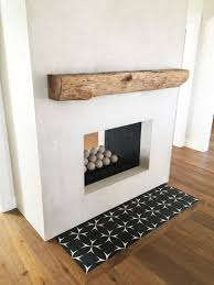 rustic rough hewn mantel grey stucco fireplace with cement tile hearth