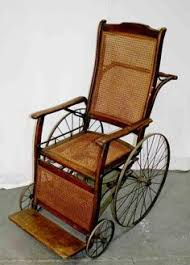 A VICTORIAN MAHOGANY BERGERE INVALID S WHEEL CHAIR MID 19TH