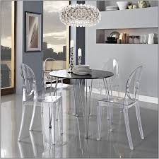 amazing dining room with round black dining table chrome legs finish and ghost dining chair ikea plus crystal chandeliers
