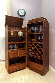 Portable Liquor Cabinet Wooden Portable Home Bar With Wheels In Corner Of Room Stock Photo
