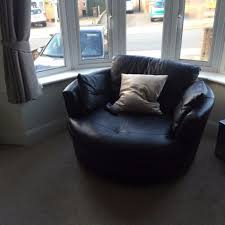 dfs black leather chaise sofa round cuddle chair and footstool
