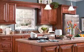 a kitchen with cabinetry in rich wood grains