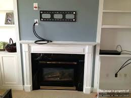 wall mount installation with wire concealment over fireplace hide tv covering niche above