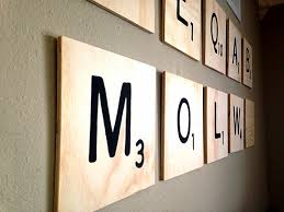 by entering our summer camp crafting blog off our second contributor lauren obregón cut and painted these super giant scrabble letters as wall decor