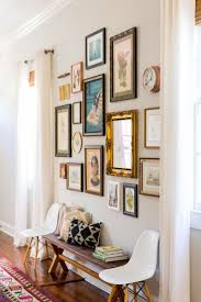 Antique and vintage touches make this hallway gallery wall a true gem.  Eames chairs and an entryway bench add more. MAKE BENCH A BAR/console table  could be ...