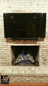 tv over a brick fireplace marlboro nj ir sensor kit equipment sound bar mounting