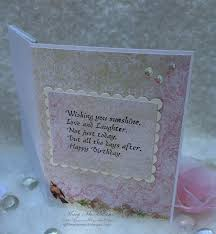the inside repeated the same papers from the outside blue fern i added another sentiment and cut to create a frame a little bling and this card is