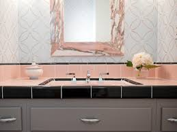 contemporary bathroom vanity with black and pink tile