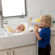 brother with baby in blooming bath
