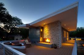 indoor outdoor fireplace living room contemporary with design chandeliers