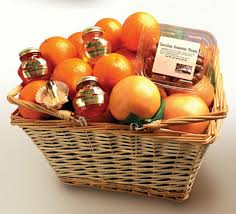 two handled wicker basket filled with oranges tangaerines gfruit chocolate amaretto pecans