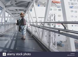 Ship Gangway Design A Young Woman In A Brown Hat Boards The Carnival Inspiration