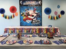 we decided on a complimentary color for both themes and included table decor wall decor included a theme poster with tassels and fans kids joint birthday
