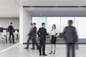 suits office. Rear View Of People In Suits An Open Office With Rows Computers And A S