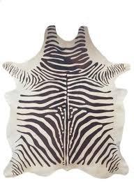 cowhide zebra rug dark brown and cream by trophy