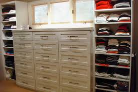 triple dresser with double and triple hanging and shaker drawer fronts closets